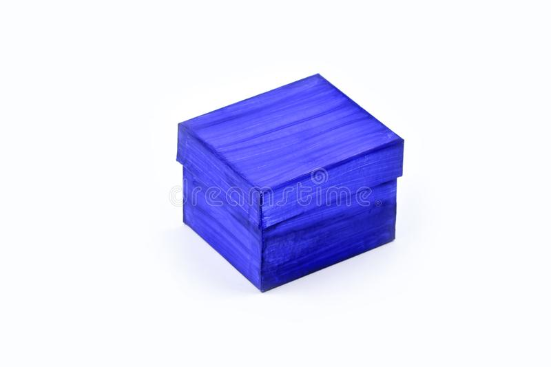 Blue gift box painted with watercolors by a child isolated on white background stock images