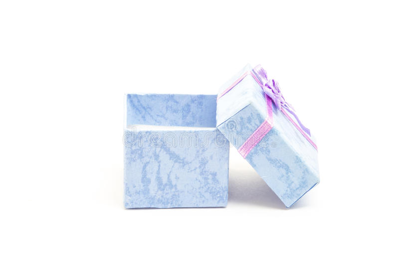 Blue gift box with purple ribbon leaning against another