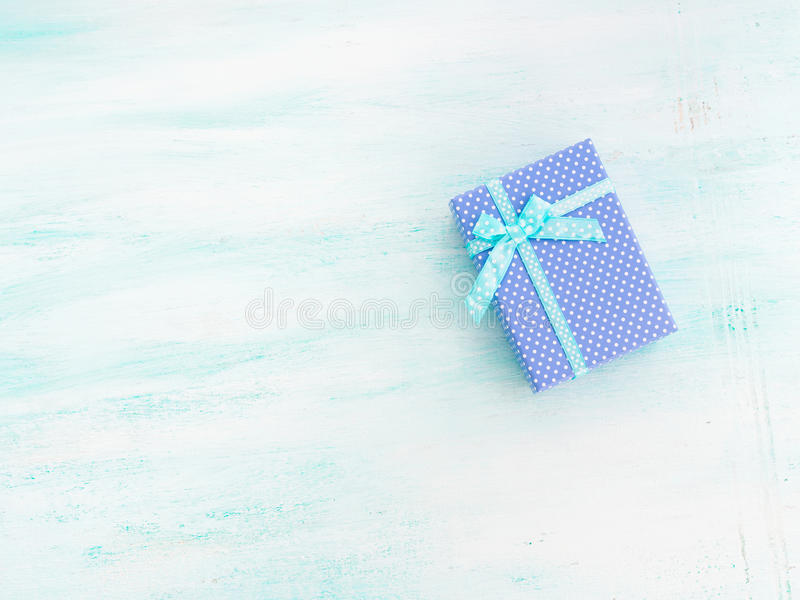 Blue gift box with ribbon pastel background. Fathers day. Blue gift box with ribbon on pastel background. Copy space top view father`s day Christmas special stock photos