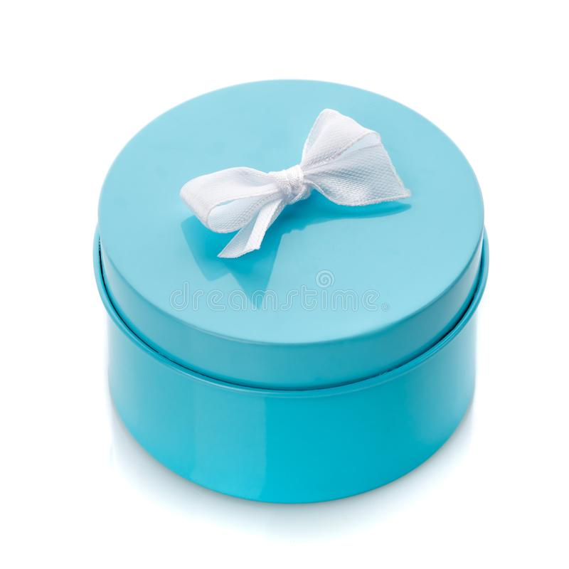 Blue gift box with white bow isolated. On white royalty free stock photography
