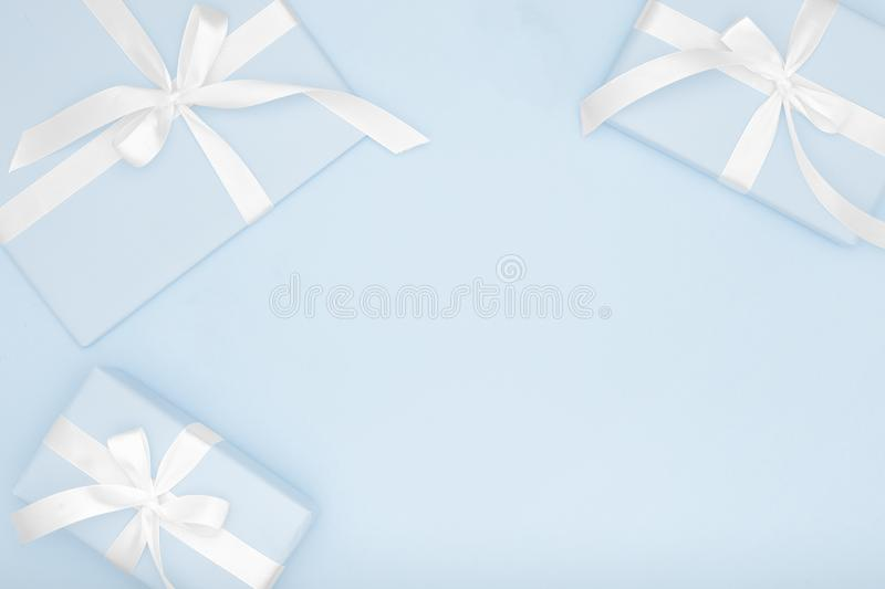 Blue gift or present box flat lay composition Valentine day or women day, greeting card birthday on pastel blue background. royalty free stock images