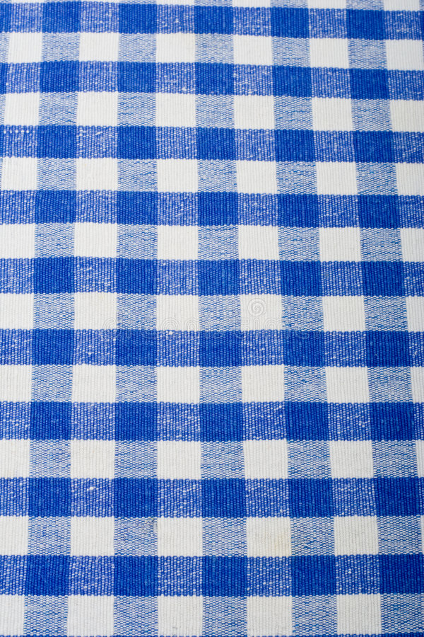 Blue gingham. Close up of blue gingham/ checked cloth royalty free stock photo