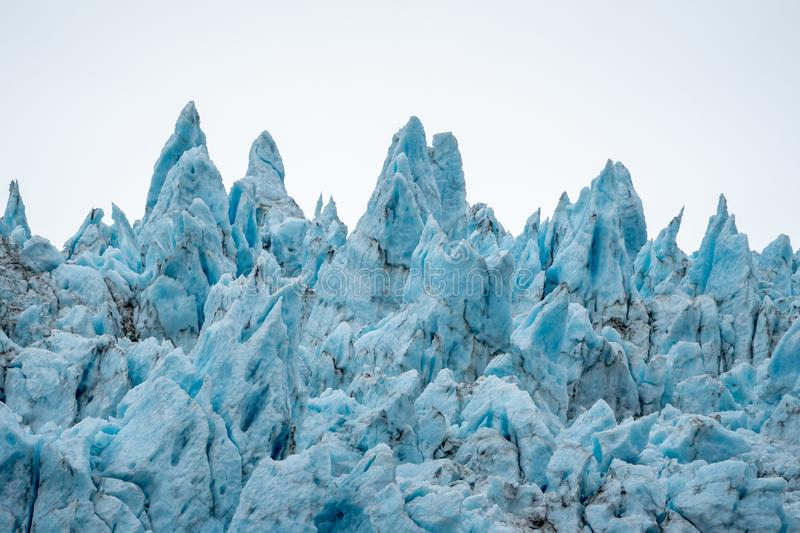 Close up view of the jagged blue ice of Holgate Glacier in Alaska`s Kenai Fjords National Park royalty free stock photos