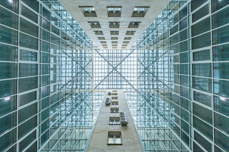 Blue glass ceiling. And windows in modern office building royalty free stock image