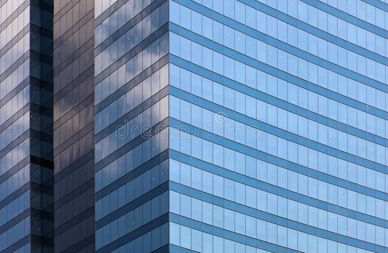Blue glass office building facade background day view royalty free stock images