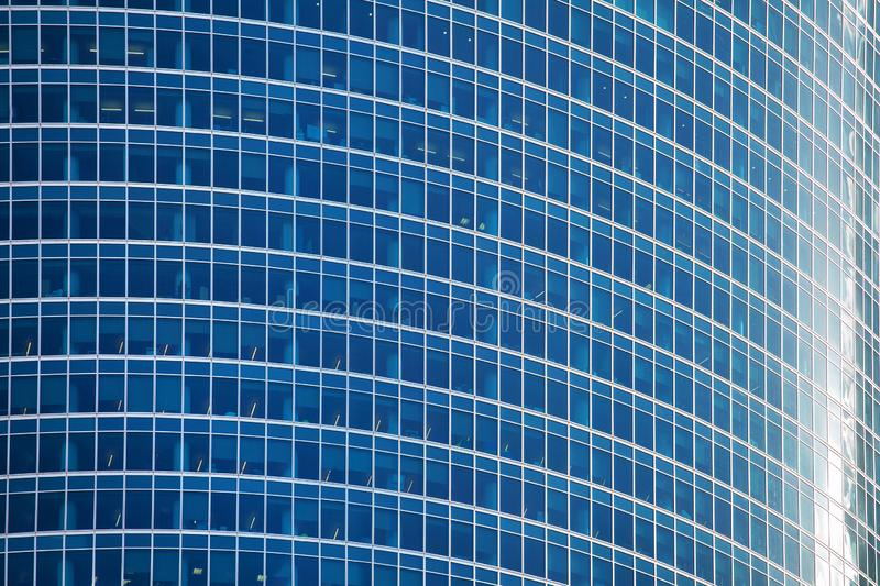 Blue glass skyscraper wall surface close up, modern business center view, financial city district, commercial downtown design royalty free stock photography