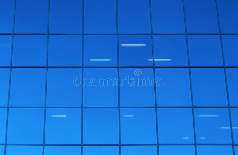 Blue glass windows office skyscraper building background stock photo