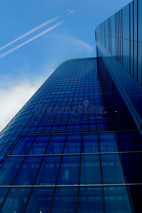 Blue glassy office building royalty free stock images