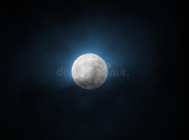 Blue glowing full moon at supermoon 31 january 2018 in a black sky stock image