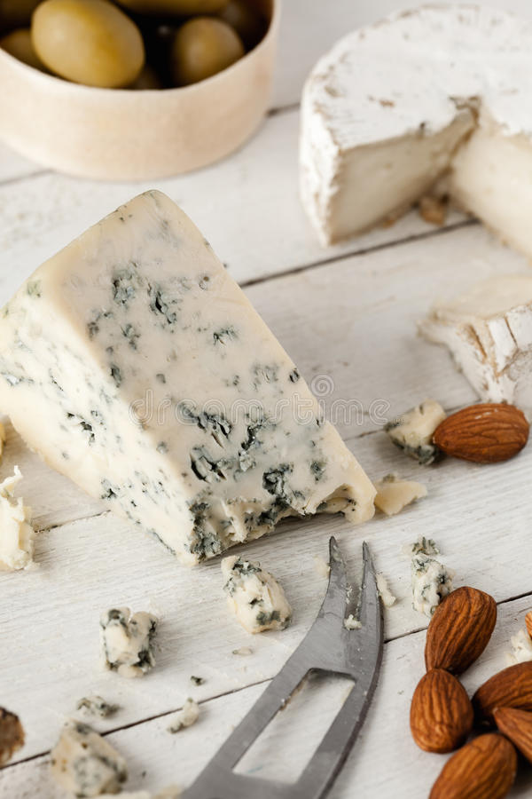 Blue And Goat Cheese. Preparing Tasty Snack With Blue Cheese, Goat Cheese And Olives royalty free stock images