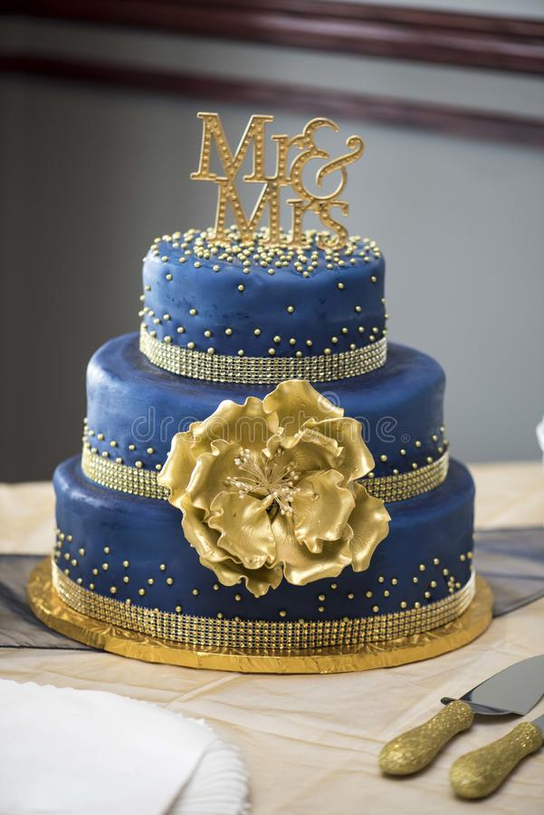 Blue and gold cake. Wedding mr & mrs stock images