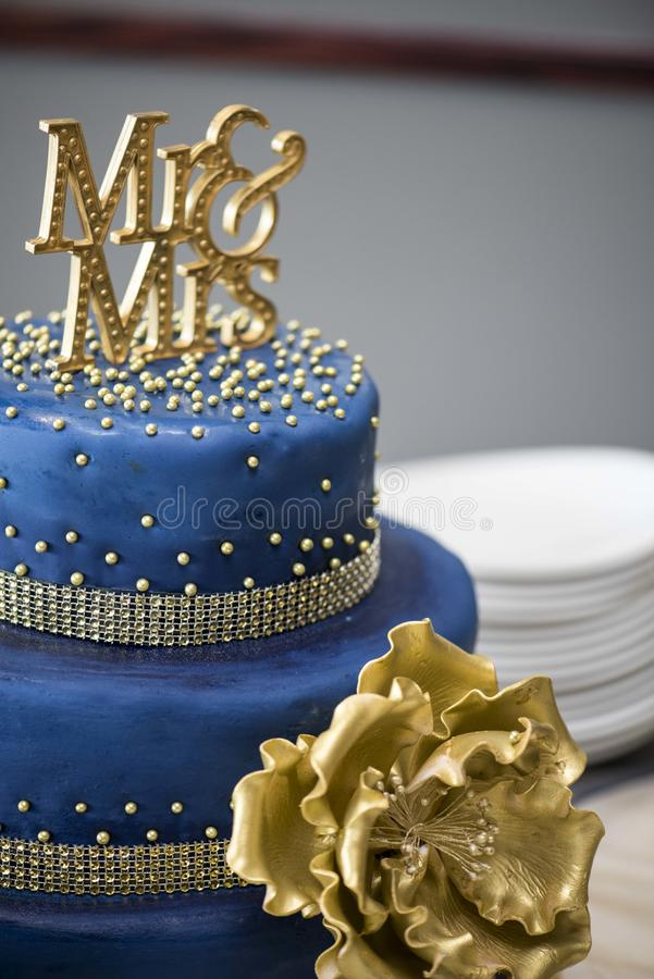 Blue and gold cake. Wedding mr & mrs royalty free stock photography