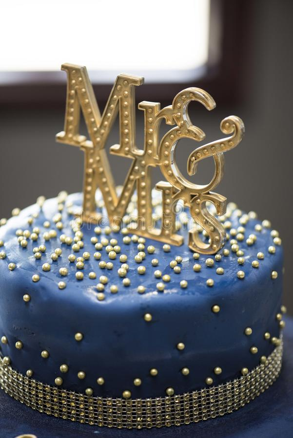 Blue and gold cake. Wedding mr & mrs royalty free stock photos