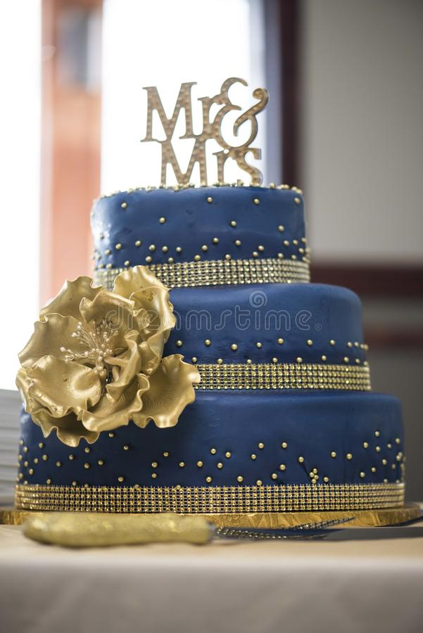 Blue and gold cake. Wedding mr & mrs royalty free stock photo