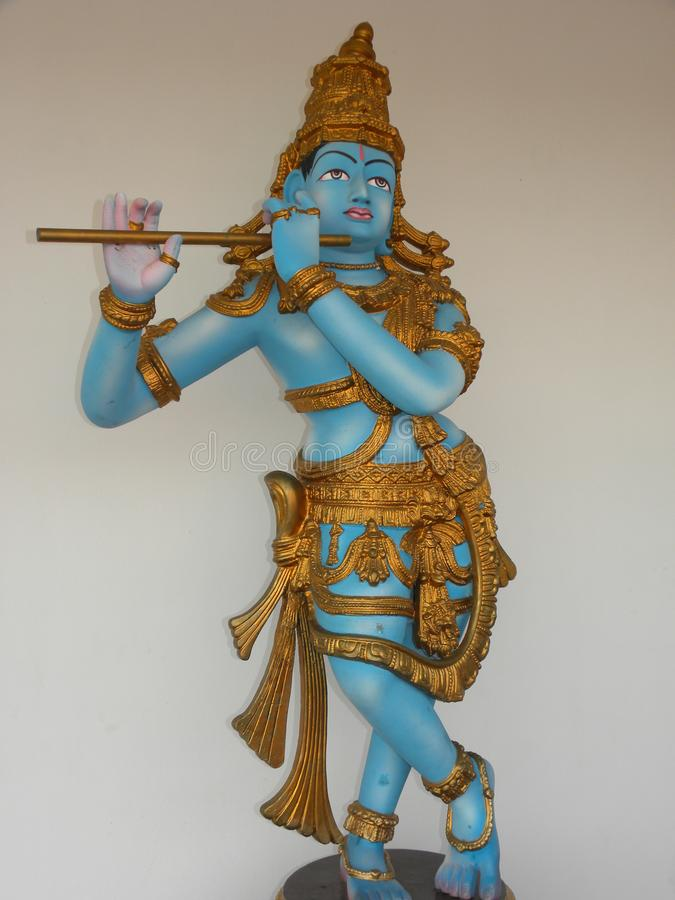 Hyderabad, India - January 1, 2009 Statue of Lord Krishna with flute at Ramoji Film City stock photography