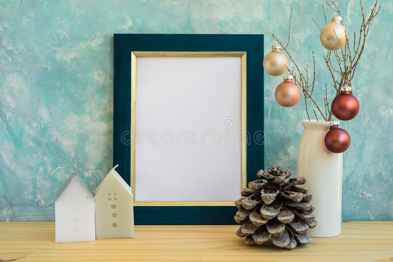 Blue and golden frame mock up, Christmas, New Year, pine cone, colorful baubles, house candles, space for quotes royalty free stock photo
