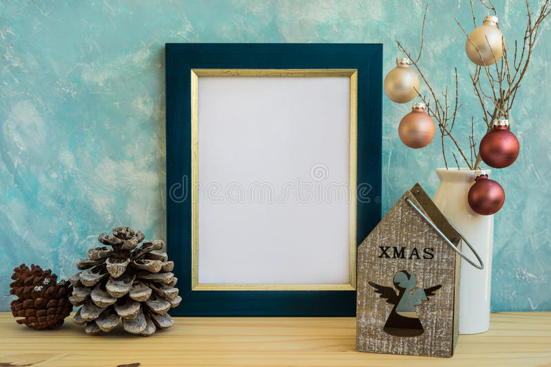 Blue and golden frame mock up, Christmas, New Year, pine cones, colorful baubles, candle holder with angel figure stock image