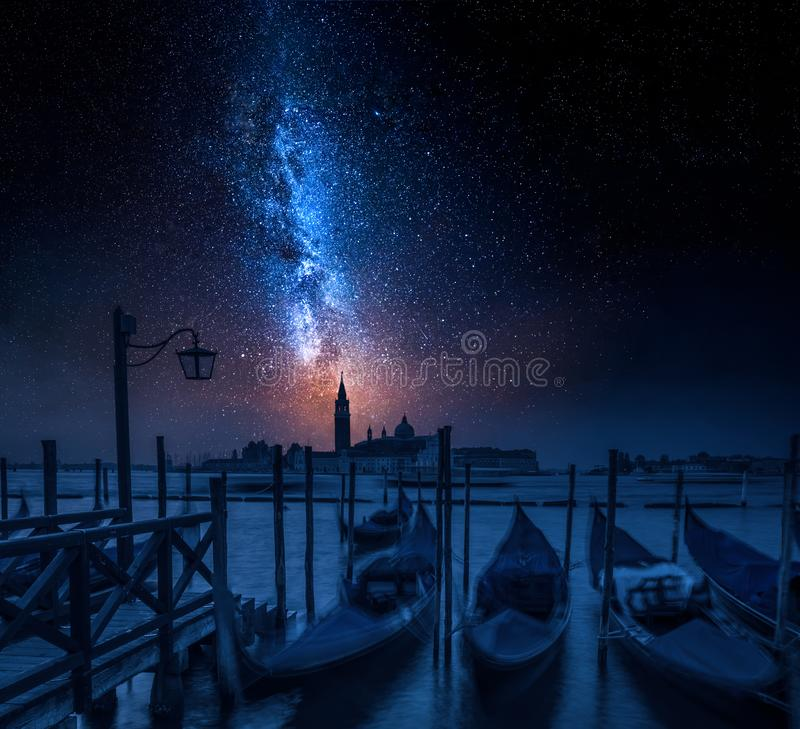 Blue gondolas in Venice at night with stars. Europe stock image