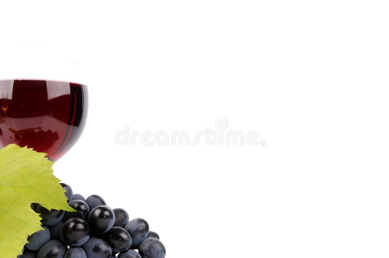 Blue grapes with leaf and wine in the glass. Alcohol, background, bar, beverage, blank, cabernet, celebration, clean, clear, closed, drink, elegance, food royalty free stock images