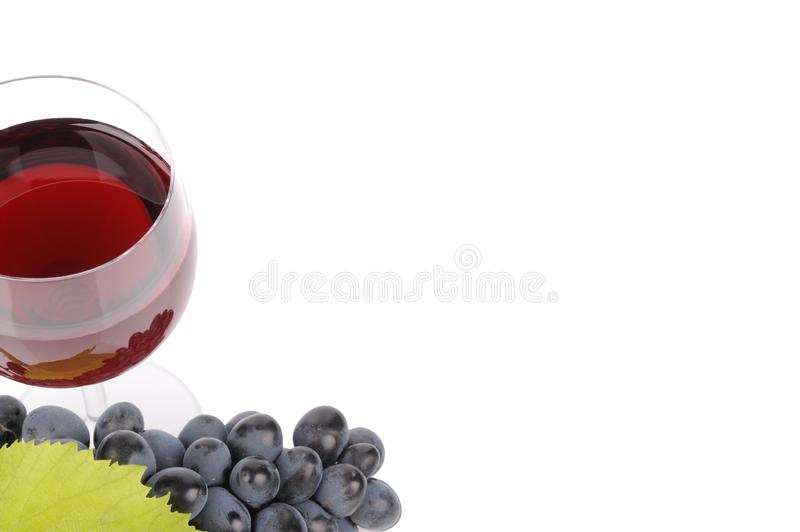 Blue grapes with leaf and wine in the glass. Alcohol, background, bar, beverage, blank, cabernet, celebration, clean, clear, drink, elegance, food, full royalty free stock photo