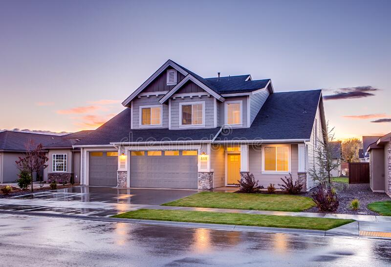 Blue and Gray Concrete House With Attic during Twilight stock photography