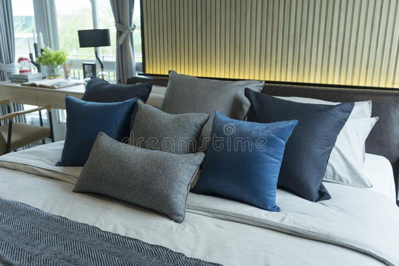 Blue and gray cushion in master bedroom with modern furniture royalty free stock photo