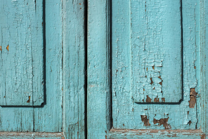 Blue gray paint mottled wooden doors stock photography