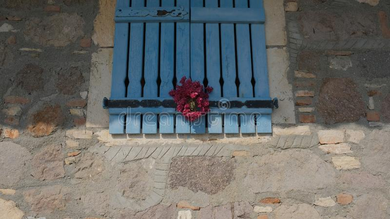 A blue greek house window stock photos