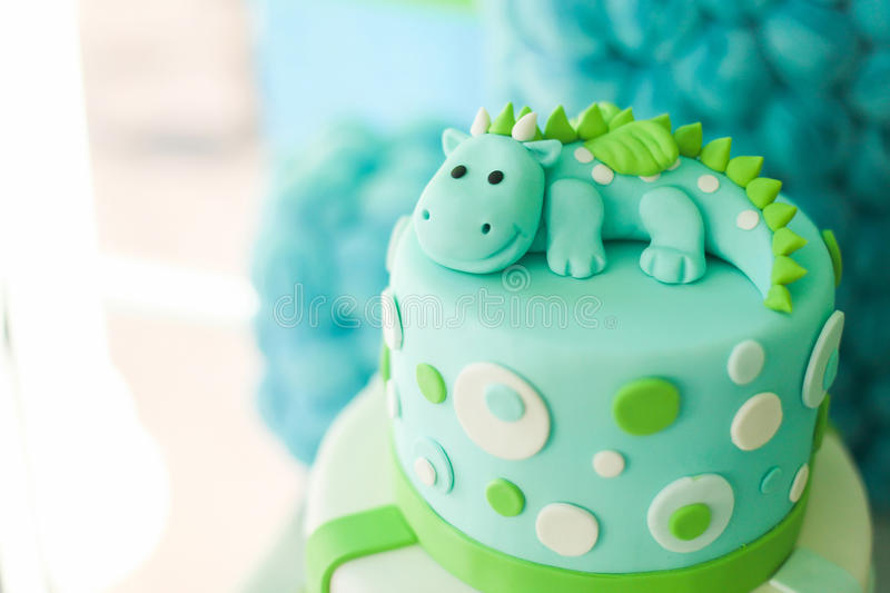 Blue and green birthday cake with cute dragon. Blue and green first year birthday cake with cute dragon, for little boy royalty free stock images