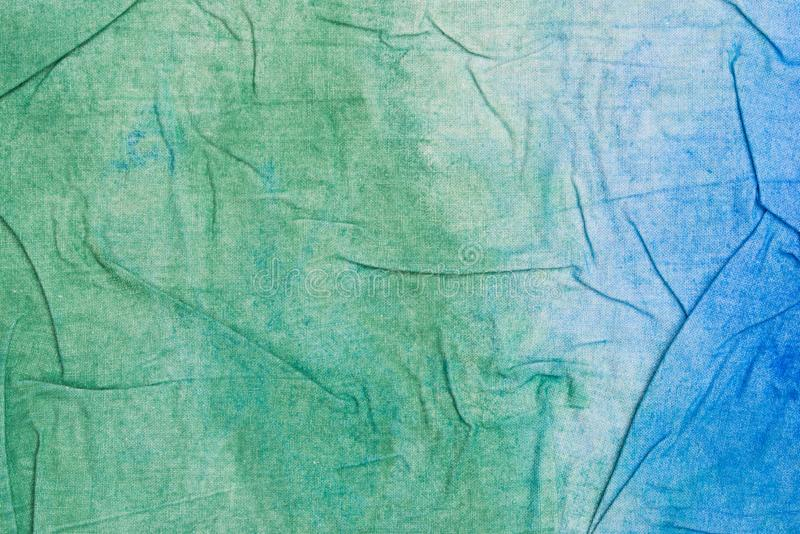 Blue and green creased painted textile background. Blue and green color painted textile background royalty free stock image