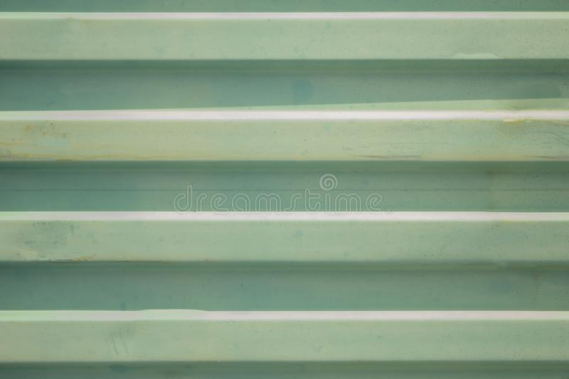 Blue green metal wall with horizontal white stripes and shadows. rough surface texture royalty free stock photos