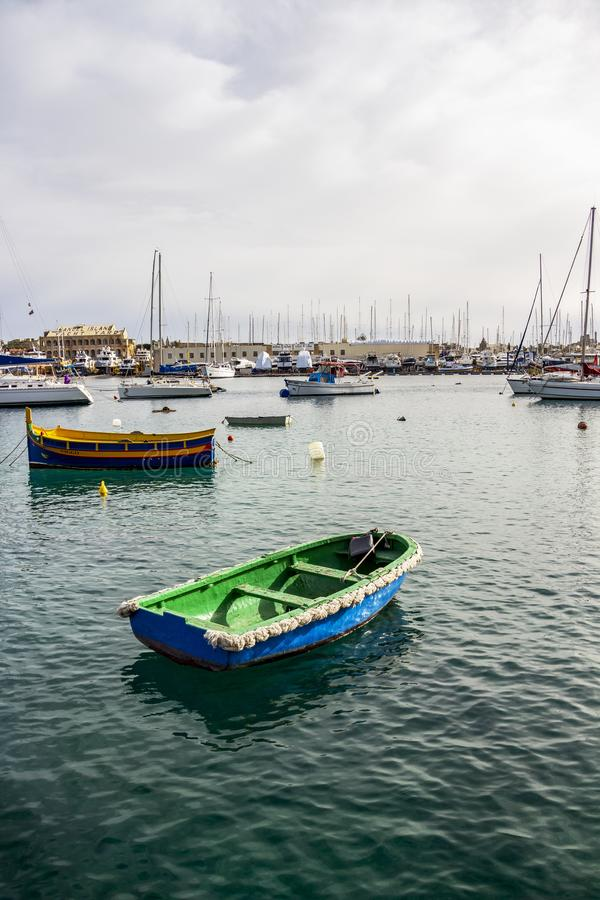 Blue and green old wooden boat at Manoel Island Yacht Yard in Gzira, Malta. MANOEL ISLAND, GZIRA, MALTA - MARCH 06, 2018: Blue and green old wooden boat at stock photography