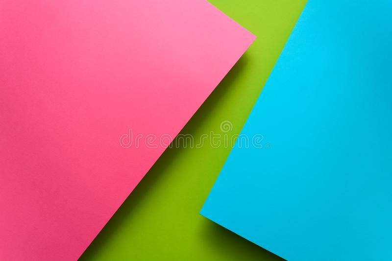 Blue, green and pink pastel colored paper background. Volume geometric flat lay. Top view. Copy space stock photos