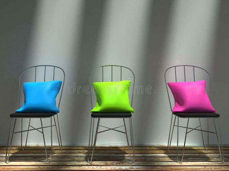 Blue, green and pink stylish cushions resting on chairs stock photo