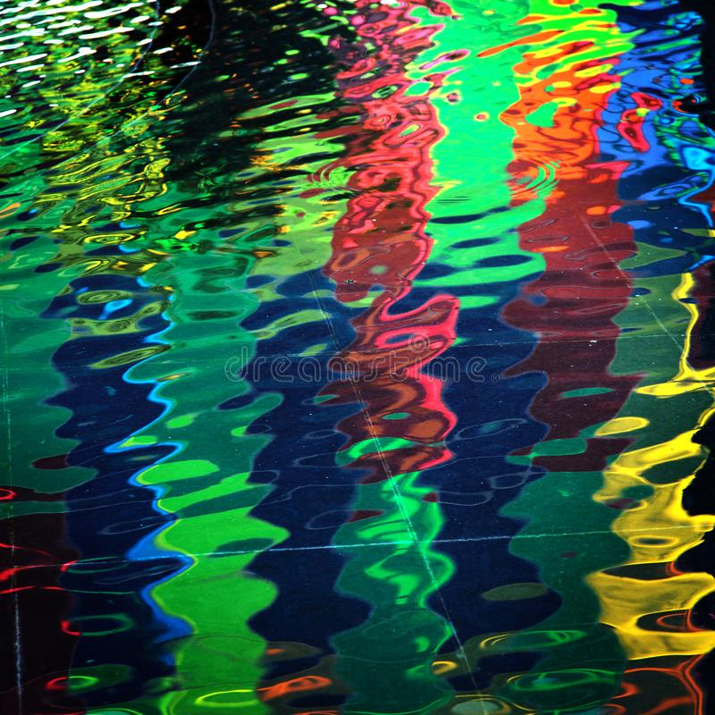 Colors lighting reflexion in water stock images