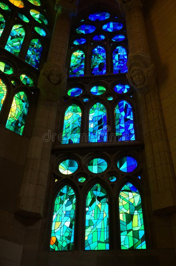 Blue and Green Sagrada Familia Stained Glass Window royalty free stock image