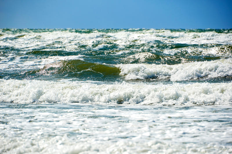 Blue green stormy sea. Blue green water in stormy sea royalty free stock image