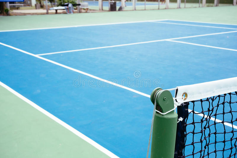 Blue and green tennis court surface,Tennis ball on the field.  royalty free stock photo