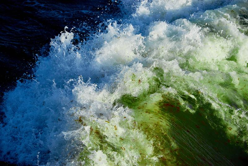 blue green water in stormy sea stock images