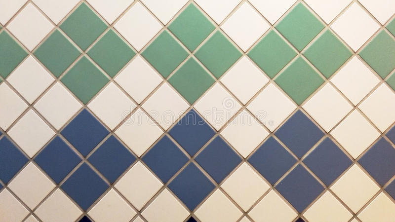 Blue, green and white real tiles in a vintage pattern. stock photos