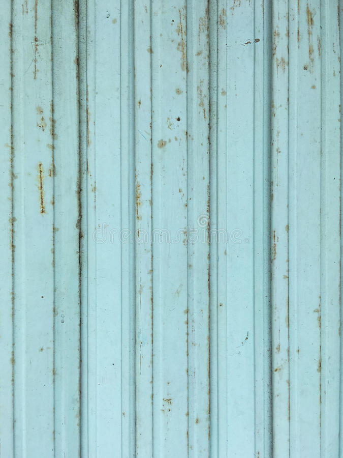 Blue grunge metal door and wall texture royalty free stock photo