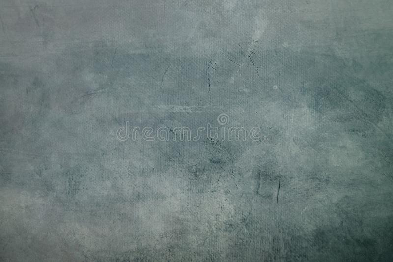 Blue grungy canvas background or texture. Grungy painting draft background or texture stock images