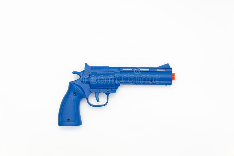 Blue gun toy made of plastic isolated on white background royalty free stock images