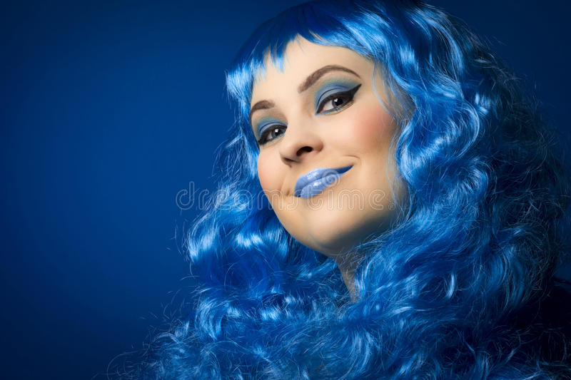 Blue hair and make-up royalty free stock image