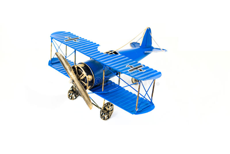 Blue Hand Made Toy Plane. This blue hand made toy plane is made by metal. The toy plane has a propeller and three wheels stock image