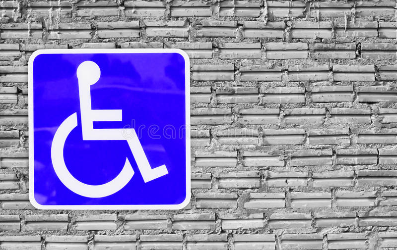 Blue handicap parking or wheelchair on wall brick . royalty free stock images
