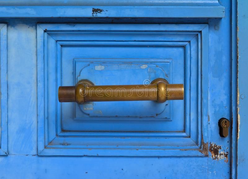 Blue handle door rusty iron handle stock image
