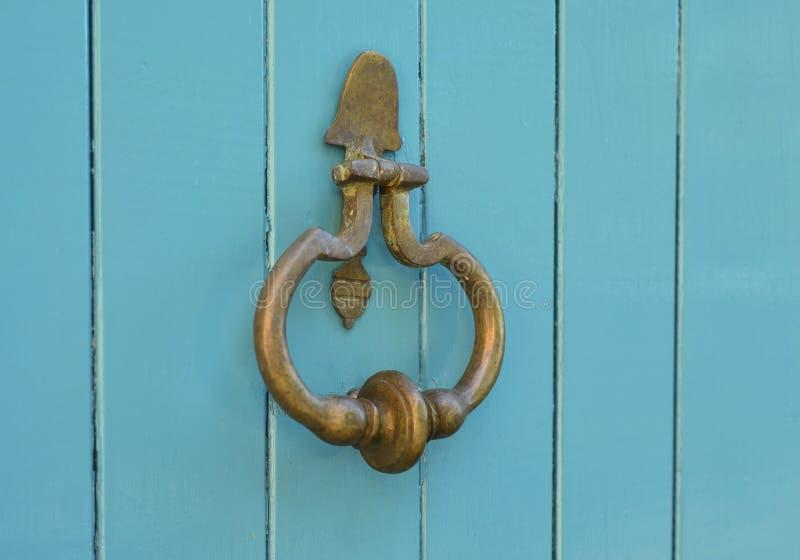 Blue handle door rusty iron ring stock photos