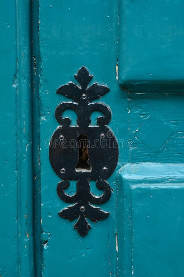 Blue handle door rusty iron handle stock images