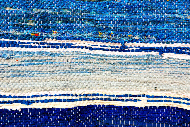 Blue handmade rug tekxure pattern.Background. royalty free stock photography